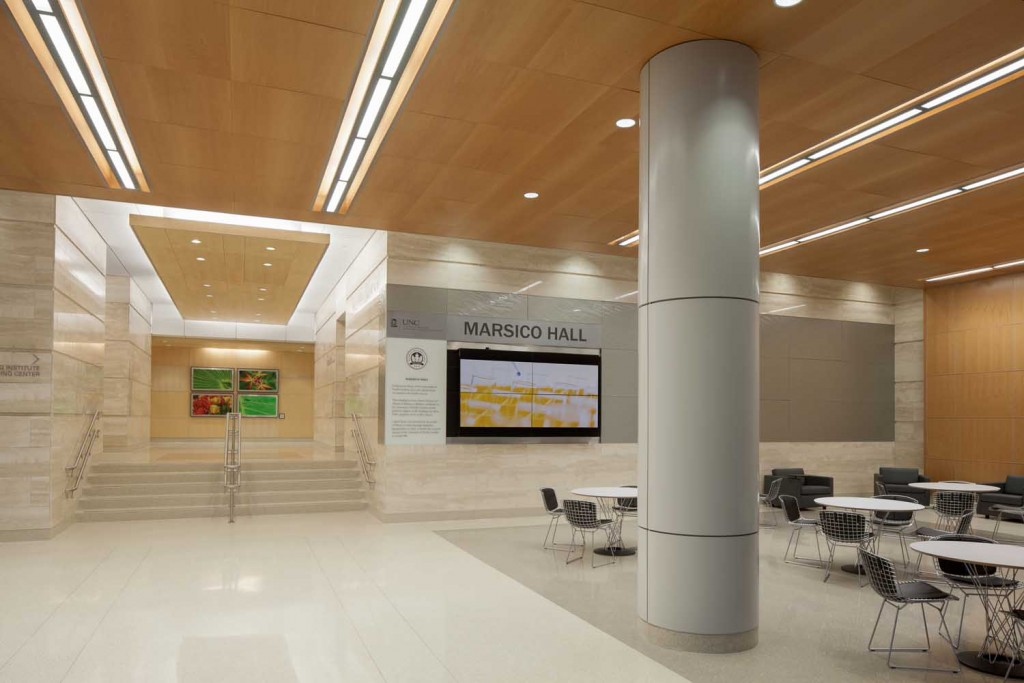 Clad in terrazzo flooring, wood, travertine, and metals, the lobby of Marsico Hall invites students and researchers alike to enter into this premiere facility. Featuring three elevators, two lounge areas, and multiple video directory screens, Marsico's lobby hints at the vast amount of technology housed within the facility. Credit: Sterling Stevens, Sterling E. Stevens Design Photo
