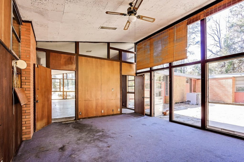 Is this a tear-down, or can the mid-century modernist house be recovered?
